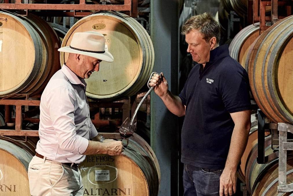 QUALITY: Chief winemaker Robert Heywood (right) and CEO Adam Torpy check a barrel sample in the Taltarni winery.
